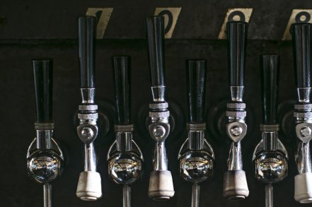 wine on wall tap